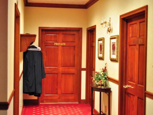 Hallway to restrooms and coat rack