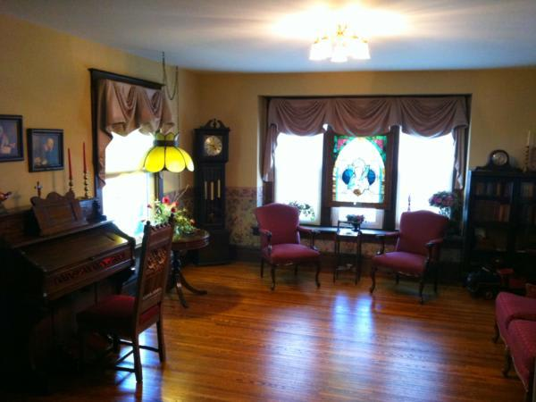 This is a photo of the original farm house family room, this room is located in the front of the Funeral Home