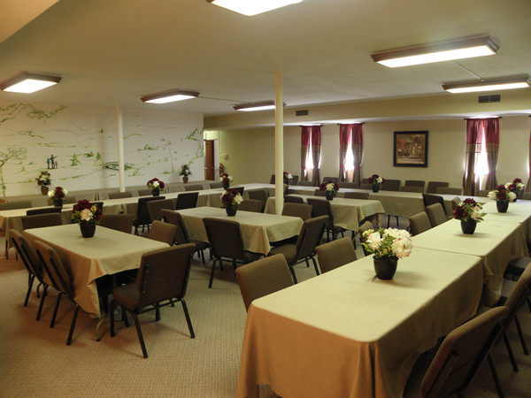 Our banquet room seats 80 people and is used by many families for after their after service meals.  A full service kitchen adjoins the room.
