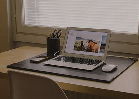 Laptop on a desk to illustrate Funeral Service Resources are only a click away