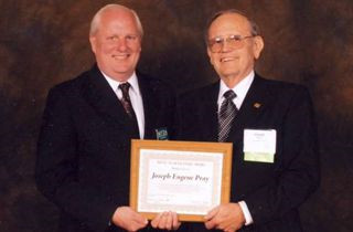 Joe Pray Sr receives award from MFDA President Chris Anderson
