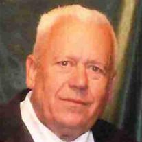 Louis Arland Komro Jr.