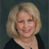 Mrs. Carol A. (Riha) David