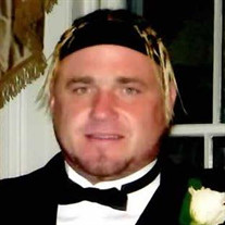 Greg M. Woodward