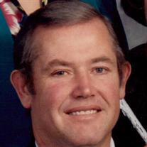 Dennis L. Strand