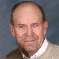 Raymond  E. Behnke
