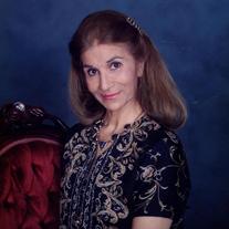 Julia M. Dib