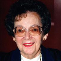 Mrs. Miriam E. Basil