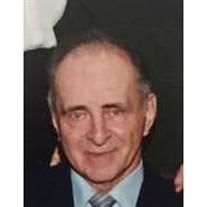 James E. Devine