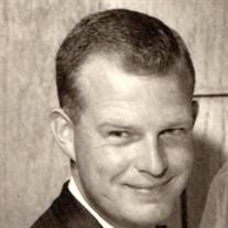 Tom E.  Grigsby