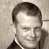 Tom E.  Grigsby