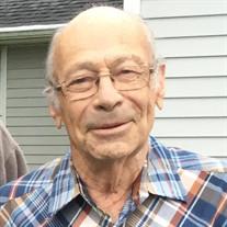 Charles  E.  Benekam