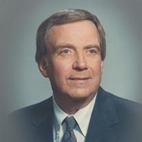 Dr. Conrad E. Larson