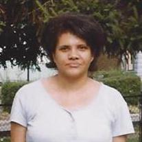 Shelia E.  Grate