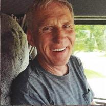 Gary E.  Adams