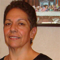 Helen M. Godina-Zapien