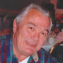 Claude A. Powali
