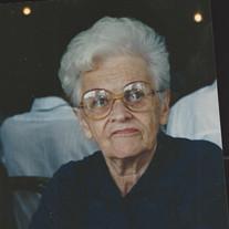 Julia L.  Devine