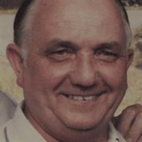 "Kenneth ""Tom"" E. Hills"