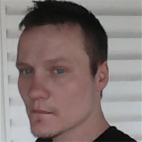 Travis M Robinson