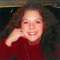 Dina B. Brochu