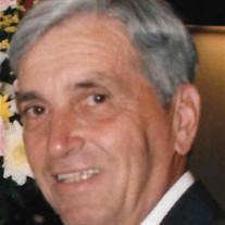 Ray E.  Hefner