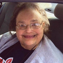 Judy E. Devaisher