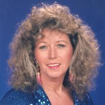 Ms. Faye Nessmith Wilson