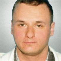 Mr. Gracjan Artur Greda