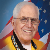 Marvin L.  Tolly