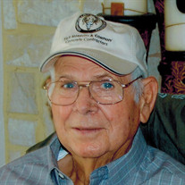 Raymond E.  Moravits