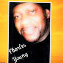 Charles E Young JR