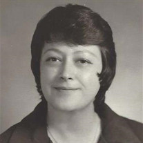 Silvia E. Flores