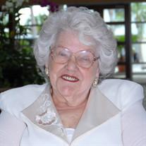 Muriel J Roach