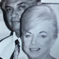 W.  Carole Aziz