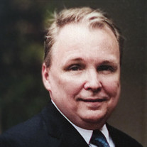 James E.  Freeman