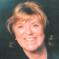 Carmen E.  Cook