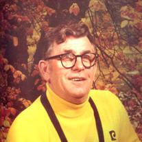 Larry E. Crumrine
