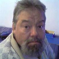 Phillip E.  Martin