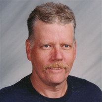 John E. Frels