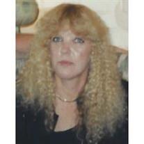 Laura J Larson