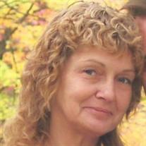 Julia D. Manues
