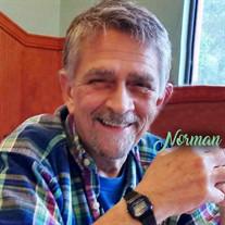 G. Norman James