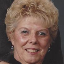 Delnora E. Travis