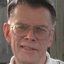 Robert E. Larkins