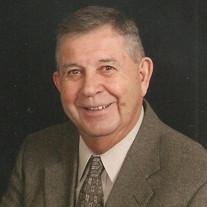 James T.  Goins