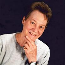 Juanima E.  Cummings