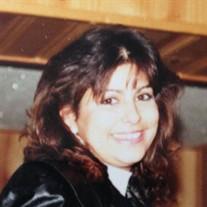Tracey E. Quintero