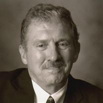 James E.  Pokorny