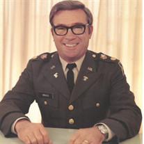 Col. (Ret.) Lucian  Joseph  Grass